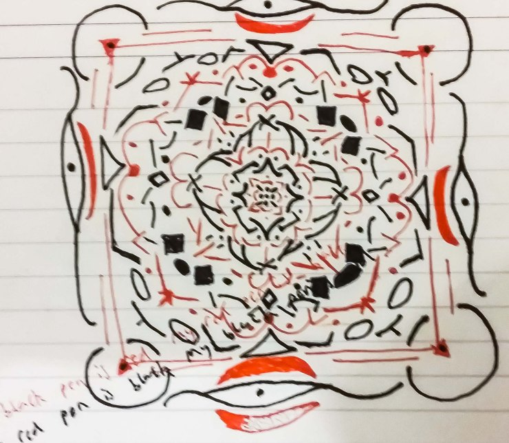 A crude mandala-style drawing using red and black biro ink on lined-paper